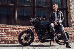 biker with classic style black motorcycle